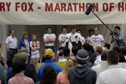 Photo of Terry Fox speaking before a marathon.