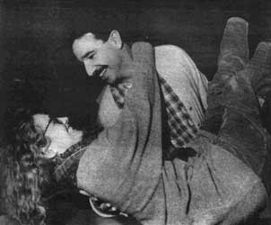 Photo from the play Zaydok showing a man holding a woman.