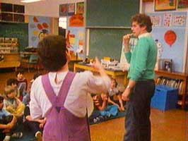 Photo from the production Feeling Yes, Feeling No of a teacher in a classroom.