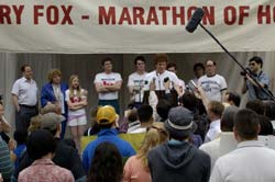 Photo of Terry Fox speaking before a marathon.
